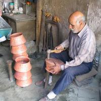 Hand hammering art on copper (Hammering)
