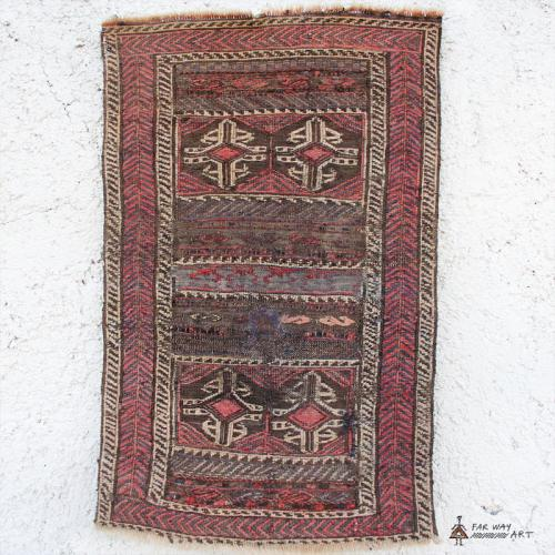Antique small Persian rug