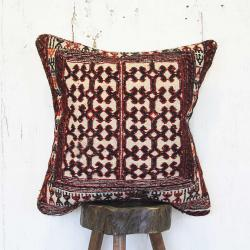 Tribal rug pillow with unique design