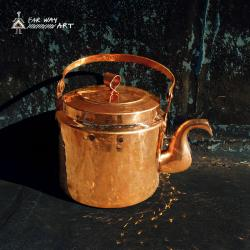 Handmade and hammered copper kettle